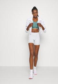 Even&Odd active - Medium support sports bra - light blue - 1