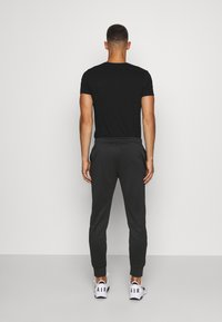 Lacoste Sport - TENNIS PANT - Tracksuit bottoms - black - 2
