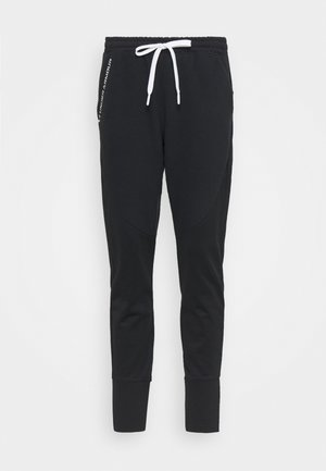 RECOVER PANTS - Teplákové kalhoty - black