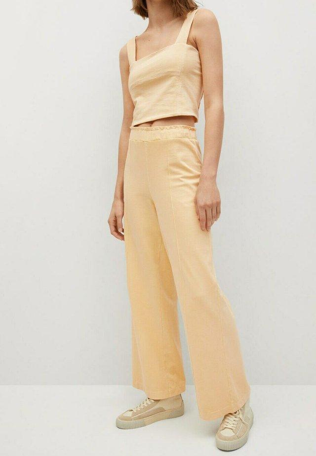 Trousers - jaune pastel