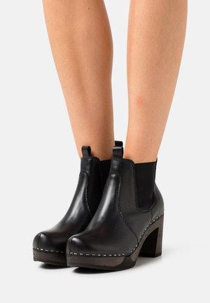 LULU - Ankle boots - bright