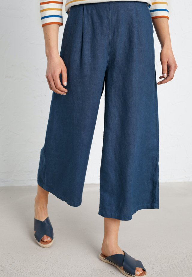 SPRING TIDE CULOTTES - Flared Jeans - dark blue