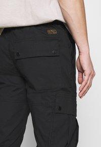 Topman - TECH BUNGEE - Cargo trousers - black - 5