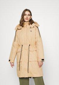 Calvin Klein Jeans - LONG UTILITY HOODED  - Winter coat - irish cream - 0