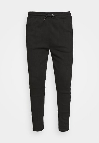 REACT TROUSERS - Trousers - black