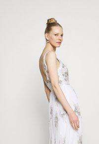 Maya Deluxe - EMBELLISHED BOW BACK DRESS - Společenské šaty - white - 3