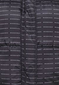 Missguided Tall - ALL OVER SMALL BRANDED PUFFER - Winter jacket - black - 5