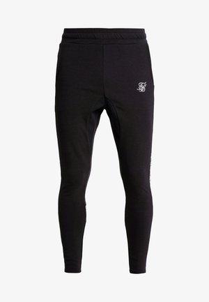 ATHLETE TECH FADETRACK PANTS - Tracksuit bottoms - black/silver