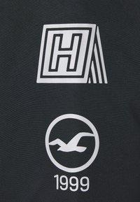 Hollister Co. - ANORAK - Light jacket - black - 5