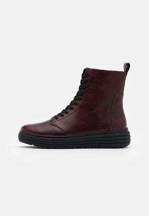 PHAOLAE - Platform ankle boots - bordeaux