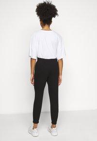 Vero Moda Petite - VMELLA BASIC PANT - Trousers - black - 2