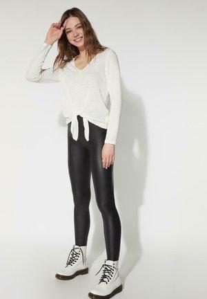 Strickpullover - bianco lino