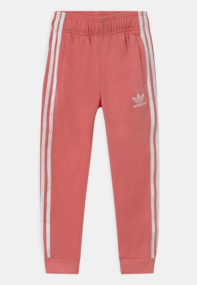 ADICOLOR SST TRACK PANTS - Verryttelyhousut - hazy rose/white