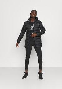 adidas Performance - ESSENTIALS DOWN - Down jacket - black - 1