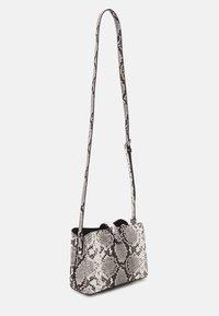 Calvin Klein - XBODY PYTHON - Across body bag - grey - 1