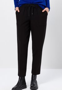 zero - RELAXED FIT - Tracksuit bottoms - black - 0