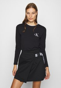 Calvin Klein Jeans - EMBROIDERY TIPPING - Long sleeved top - black - 0
