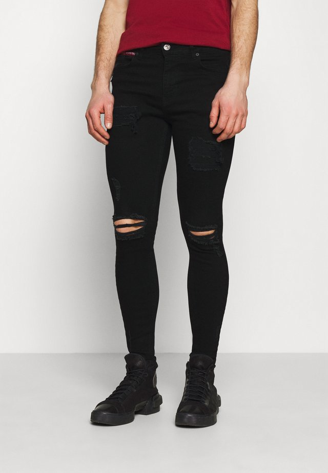 DISTRESSED SKINNY FIT - Skinny-Farkut - jet black wash