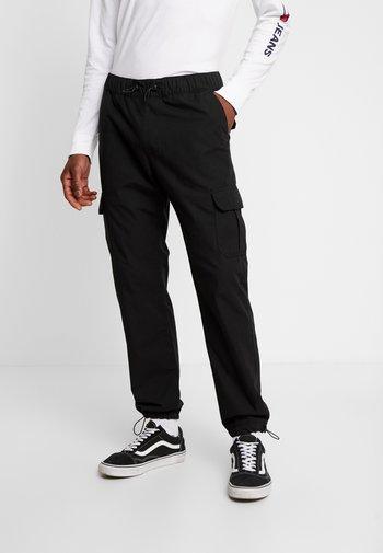 RIPSTOP CARGO PANTS - Reisitaskuhousut - black