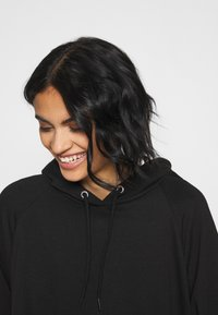 Monki - MALIN HOODIE DRESS - Day dress - black dark unique - 4