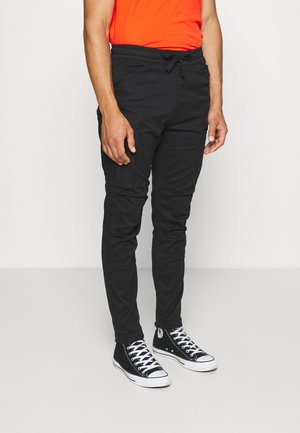 ROVIC SLIM TRAINER - Pantalon cargo - black