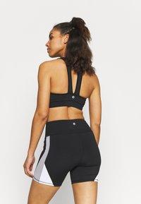 Cotton On Body - V NECK CUT OUT CROP - Light support sports bra - black - 2