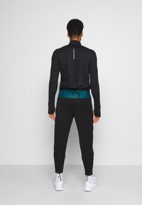 Nike Performance - SHIELD - Pantaloni sportivi - dark teal green/black/silver - 2