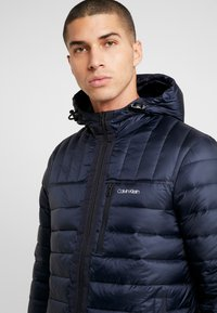 Calvin Klein - HOODED WADDED JACKET - Light jacket - blue - 4