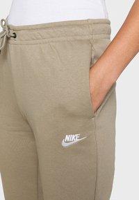 Nike Sportswear - Teplákové kalhoty - mystic stone/white - 5