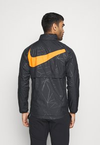 Nike Performance - NIEDERLANDE KNVB  - Training jacket - black/safety orange - 2