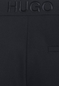 HUGO - HALERA - Trousers - open blue - 6