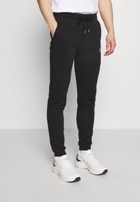 Bricktown - PANTS RED MUSHROOM - Tracksuit bottoms - black - 0
