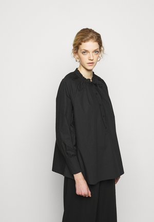 ROLAND THINKTWICE - Blusa - black