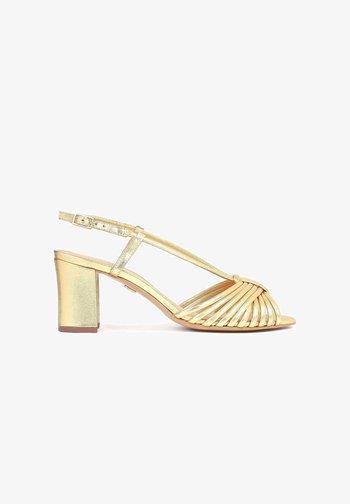NESSIE - Sandales - gold