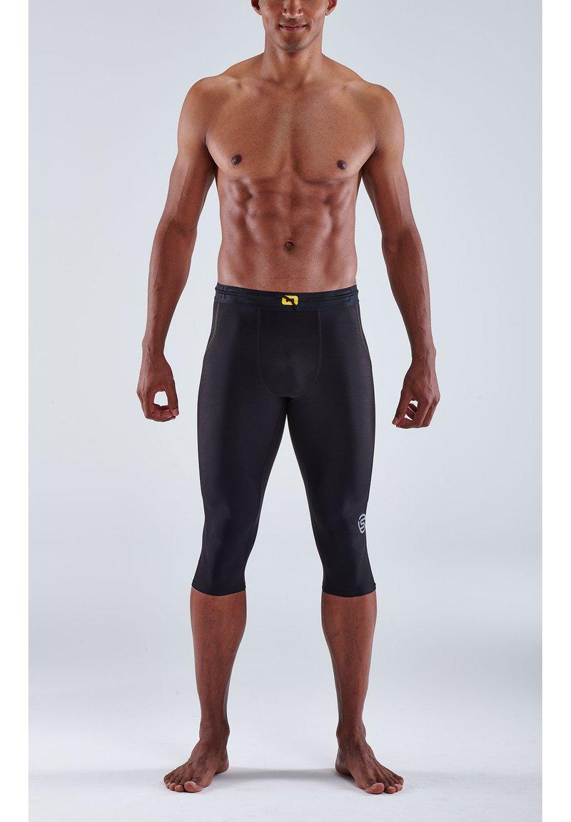 Skins - 3/4 sports trousers - black