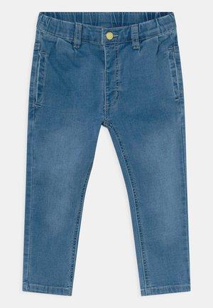JODIE - Slim fit jeans - light-blue denim