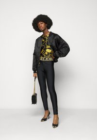 Versace Jeans Couture - Long sleeved top - black - 1