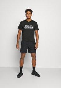 Nike Performance - MILER  - Print T-shirt - black/white - 1