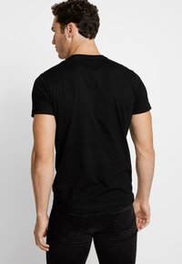 Diesel - T-DIEGO-LOGO T-SHIRT - Print T-shirt - black - 2