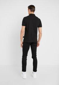 Versace Jeans Couture - LABEL POLO - Koszulka polo - black - 2