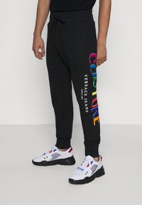 Versace Jeans Couture - ORGANIC BRUSHED - Tracksuit bottoms - black - 0