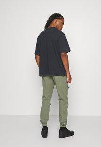 WRSTBHVR - RABIES - T-shirt med print - black washed - 2