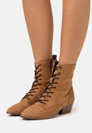 BAVIERA - Lace-up ankle boots - cognac