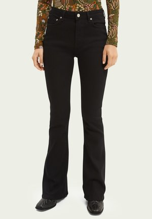 THE CHARM - Flared Jeans - black