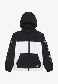 Calvin Klein Jeans - PACKABLE MIRROR MONOGRAM JACKET - Lehká bunda - black - 3