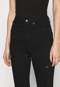 Vero Moda - VMSOPHIA SKINNY DESTROY JEANS  - Jeans Skinny Fit - black denim - 4