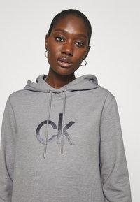 Calvin Klein - HOODED DIAMANTE DRESS - Day dress - mid grey heather - 3
