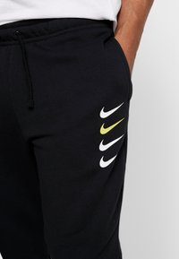 Nike Sportswear - CLUB - Tracksuit bottoms - black - 3