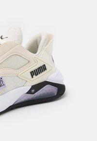 Puma - LQDCELL METHOD FM - Sports shoes - eggnog/light lavender/black - 5