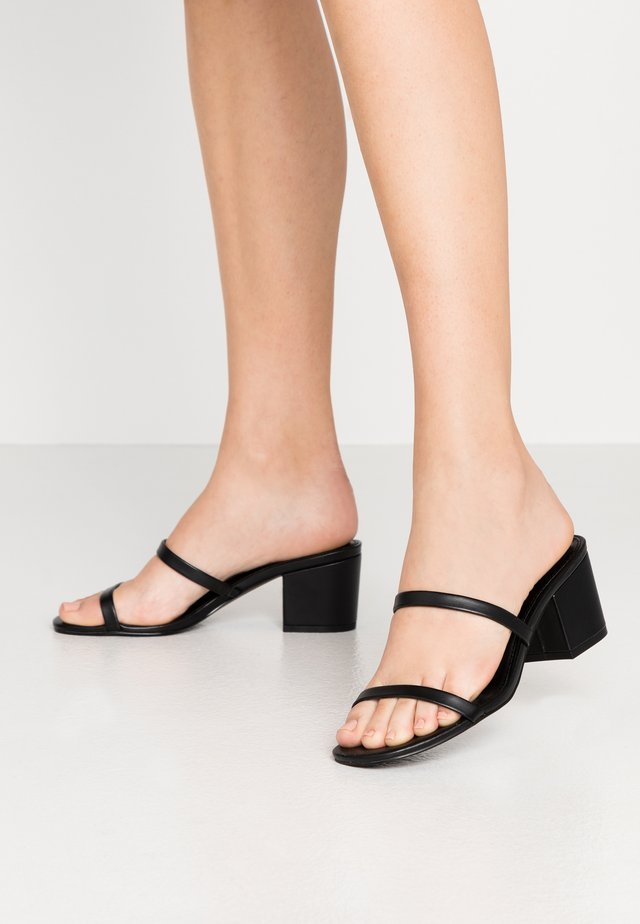 ISSY - Heeled mules - black